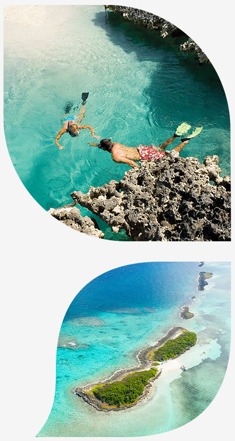 Couple snorkeling and aerial view of an island