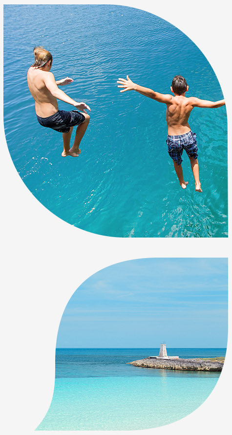 top image two boys jumping in blue ocean water bottom image beach with Island