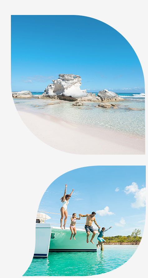 white sand beach with clear water and rocks bottom image family jumping off sailboat