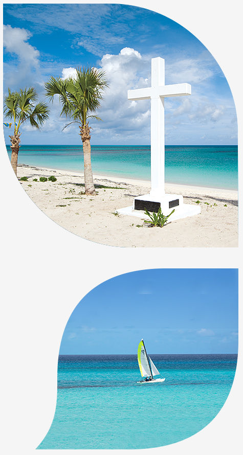 large white cross on the beach next to palm trees in the top image and sailboat in the ocean in the bottom image