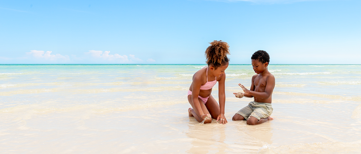 two young kidsplaying with sand